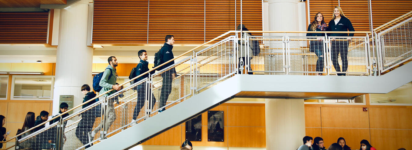 Students walking up an open staircase